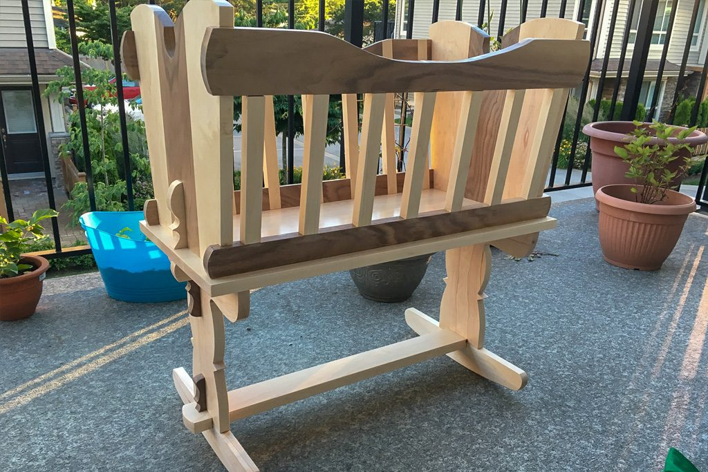 Walnut and maple bassinet