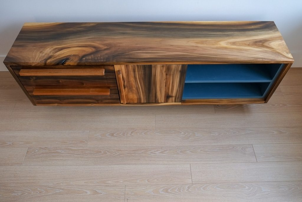 Rainbow poplar TV stand with teak accents